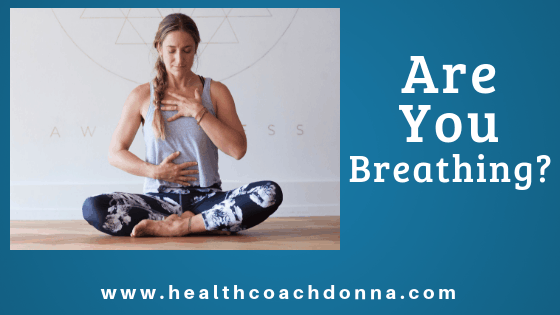 Woman doing yoga and breathing exercises