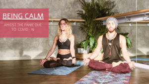 Man and woman being calm through meditation in a studio room.