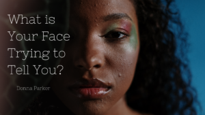 A black woman with acne staring blankly in front of the picture trying to figure out what her face is trying to tell her in terms of her health.